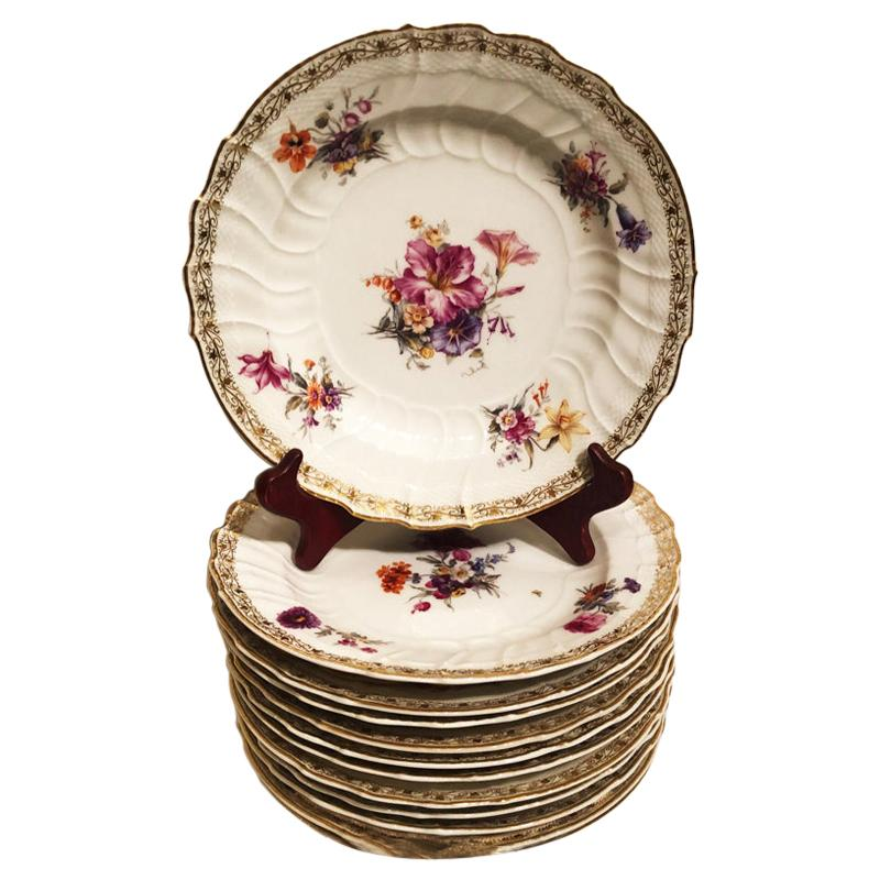 Set of Twelve KPM Dinner Plates with Different Hand Painted Floral Bouquets