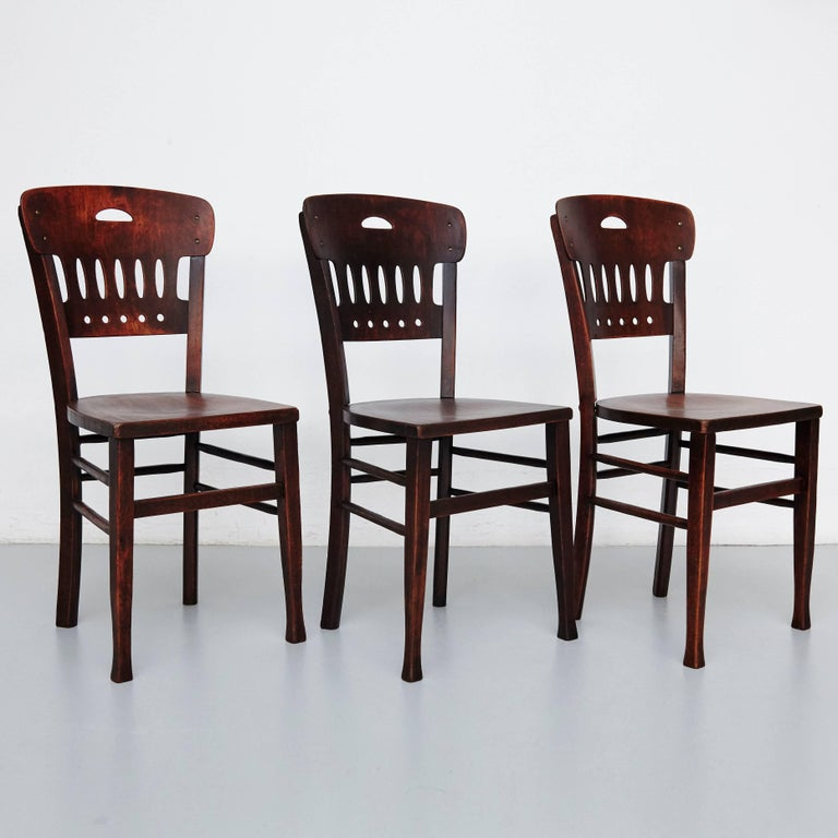 Set of 12 bistro chairs of the Lutermamanufactured in Estonia, circa 1900.  In original condition, with minor wear consistent with age and use, preserving a beautiful patina.    Chairs of the old Luterma Estonian manufactory founded in 1896 in