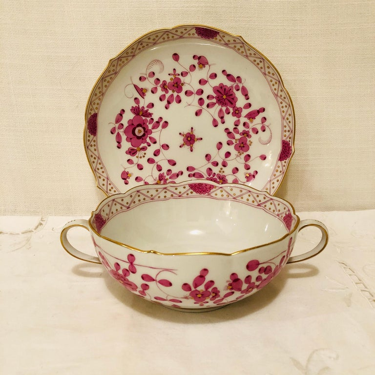 We would like to offer you this fabulous set of twelve Meissen purple Indian cream soups and saucers. These cream soups are very hard to find. In fact, in thirty years, I have never seen these before. They are very good size, and you could serve any