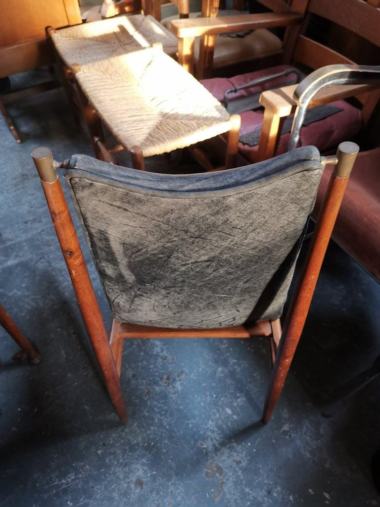 Set of 12 Mid Century Modern teak Dining Chairs with Decorative Brass Fittings In Good Condition For Sale In London, GB