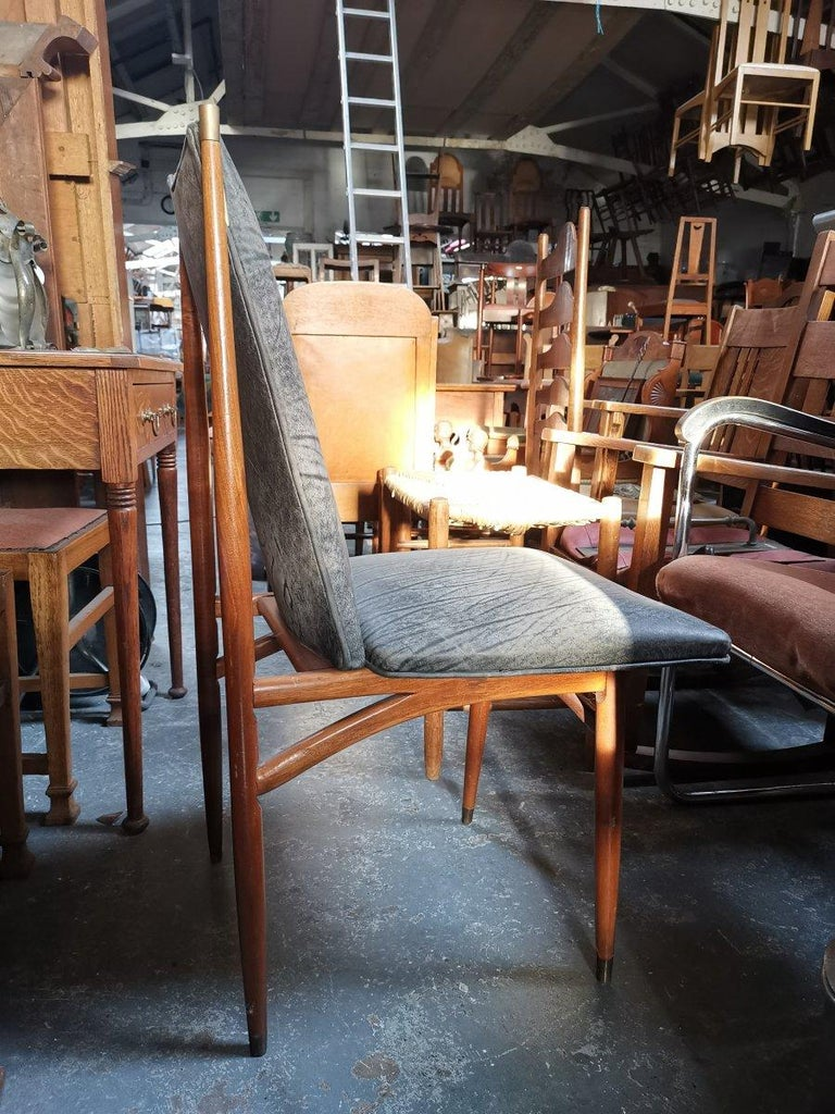 Set of 12 Mid Century Modern teak Dining Chairs with Decorative Brass Fittings For Sale 1