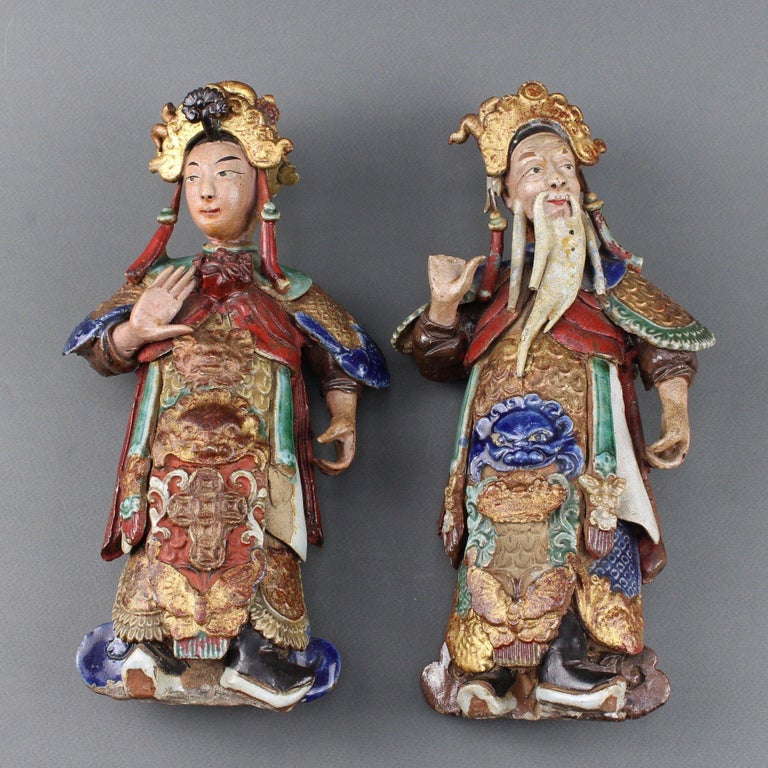 Set of two Chinese earthenware decorative wall-hanging figures (19th century). These two pieces are intriguing. Consulted experts in Asian artworks indicate they were most likely made in Canton, China for European export in the 19th century. They