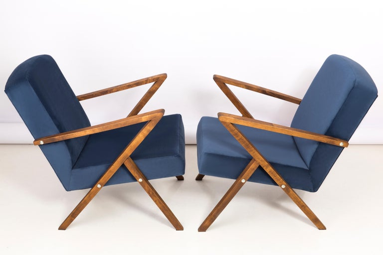 A pair of armchairs manufactured at the Bydgoszcz Renewal Cooperative in the 1970s. The armchairs are after a comprehensive renovation of carpentry and upholstery. The wood has been cleaned, cavities completed, painted with dark walnut stain,