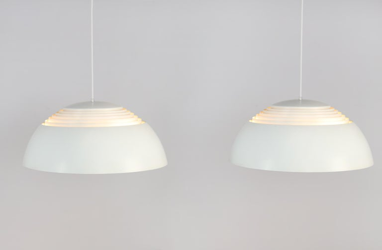 These AJ Royal lamps were designed by Arne Jacobsen for Louis Poulsen in the 1960s for the Royal SAS hotel in Copenhagen. The nice thing about these lamps is that they shine both light upwards and downwards due to the design of the lamp, which uses