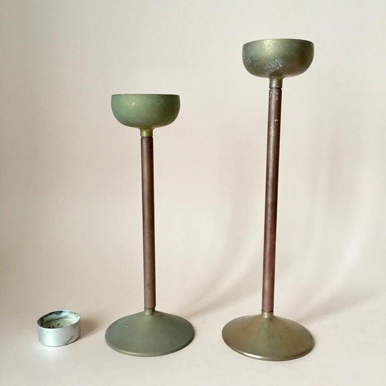 Minimalistic design, very nice original patina  Measures: Left - H 22 cm, D 8.5 cm Right - H 26.5 cm, D 8.5 cm.