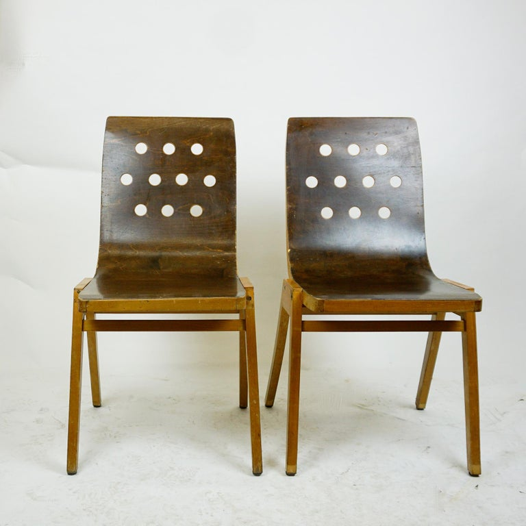 A set of two stackable beech plywood chairs designed by Prof. Roland Rainer in 1951.