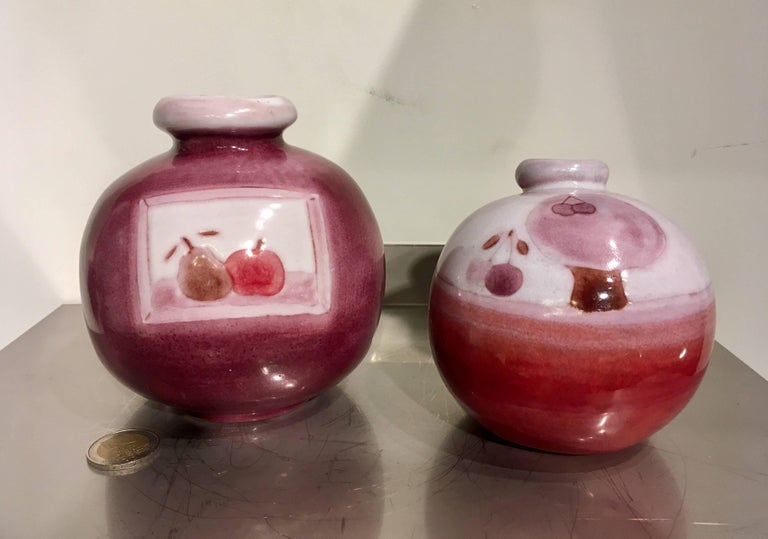 Set of two ball vases decorated with fruits (cherry, apple & peer) and tree (cherry tree), circa 1960. By Cloutier Frères, France. (Cloutier brothers). In perfect condition!  Dimensions are given for the biggest vase. (Dimensions of the