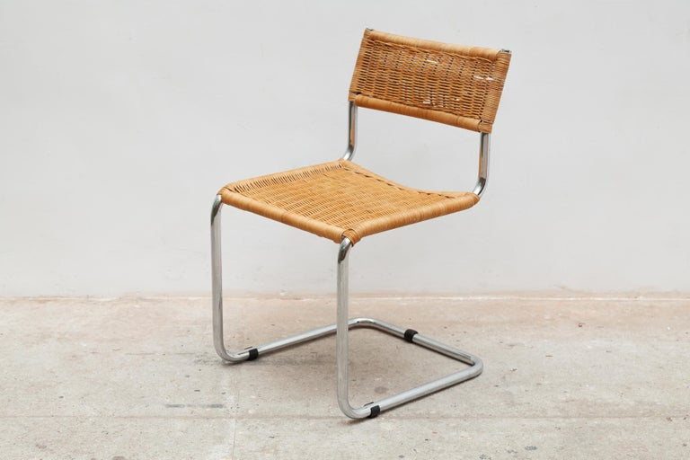 This pair of chairs was made in the 60s. It consist of a tubular chrome structure with cantilever base.The seat and the back are in woven rattan. A pretty classic reminiscent of the Cesca B32 model by Hungarian designer Marcel Breuer. Functional,