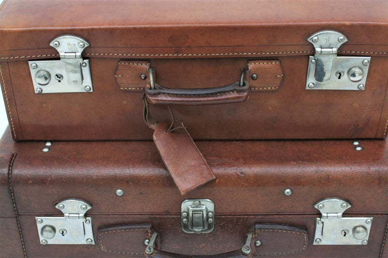 Set Of Two Brown Leather Suitcases As Side Table