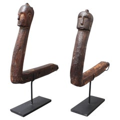 Set of Two Carved Wooden Tools with Human Faces from Nias, Indonesia