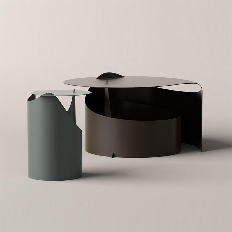 Coffee tables designed by Aldo Bakker in 2015.   A single sheet of steel rolled in one smooth motion into a self-supporting construction. Aldo Bakker's exquisite sense of merging colour, material and form has come into play to create an occasional