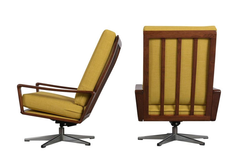 This Pair of Modern Danish Recliner Chairs are made of walnut wood with a stylish carved frame that has been newly stained and rests on a sturdy five-spoke chrome base. The seat & back cushions have been newly upholstered in yellow fabric with new