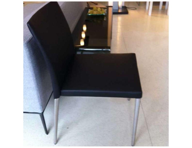 """(2) Deen side chairs Model# 1600 Deen BH 32"""" Black select leather chrome frame Original price: $2532 A chair is a chair. But it is one of the most difficult tasks there are in design. Deen fits the bill. Minimised in volume, precise in shape."""