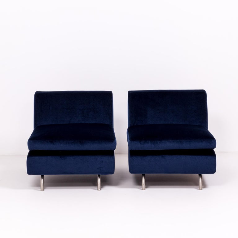 Combining modernist curves with sleek straight lines, this set of two Dubuffet lounge chairs was designed by Rodolfo Dordoni for Minotti.   Both chairs have been newly reupholstered in plush, royal blue velvet and feature metal frame with curved