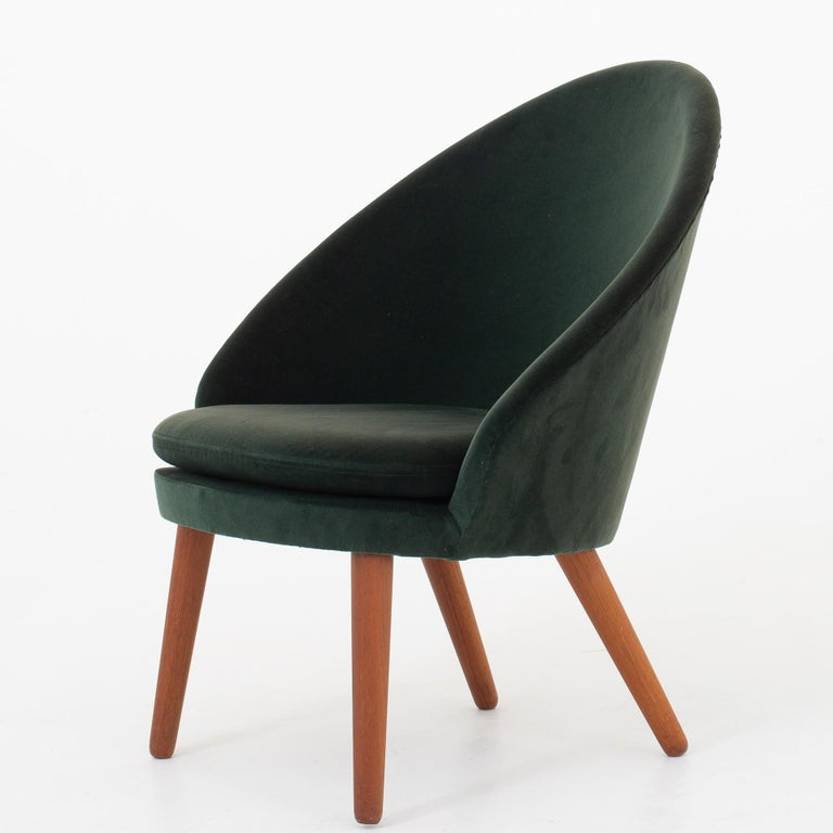 Set of easy chairs in original green velvet with legs in teak. Model 301. Maker Godtfred H. Petersen.