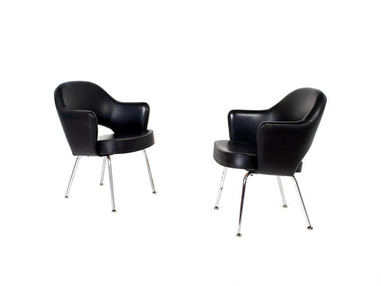 Black leather upholstery with chrome / nickel tubular legs, finished with round feet. Both chairs are in good condition; one chair has a small dent in the leather as per picture. The feet underneath the legs can be used to adjust the chair. One