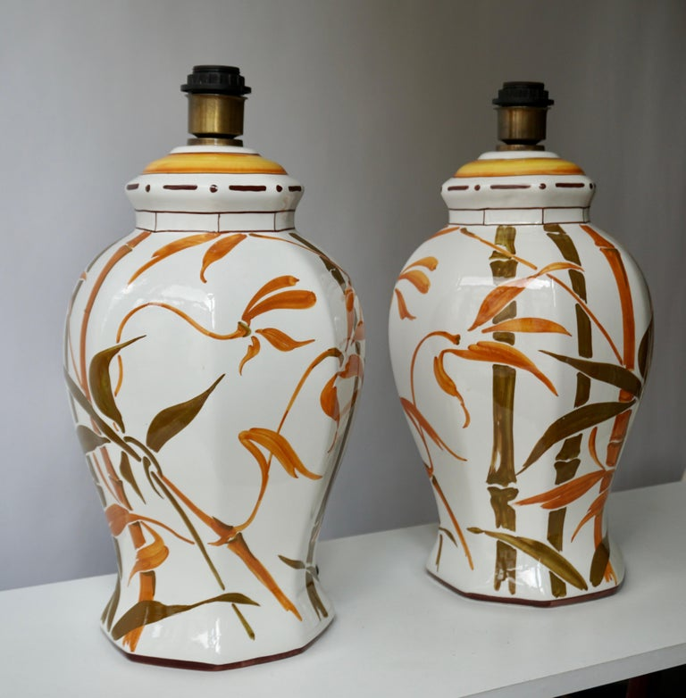Two Mid-Century Modern elegant Hollywood Regency style ceramic table lamps with hand painted bamboo leaf or botanical motif over a gloss white glaze. Lampshade not included.  Each lamp comes with 1 x E27 / 26 Edison screw fit bulb holder, is