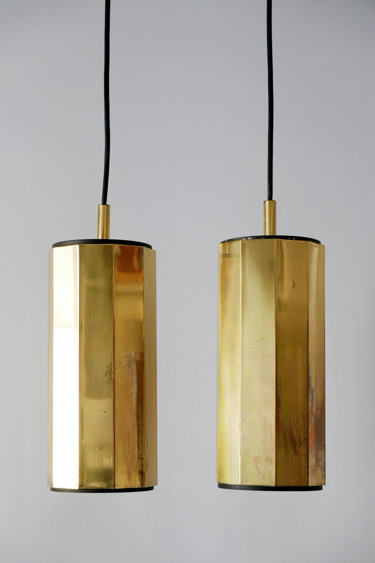 Set of two extremely rare and elegant Mid-Century Modern decagonal brass pendant lamps. Manufactured probably in Germany, 1960s.  The lamps are executed in brass and black lacquered metal. Each lamp needs 1 x E27/E26 Edison screw fit bulb. They