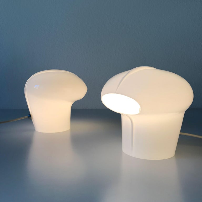 Set of two extremely rare and elegant Mid-Century Modern table lamps. Designed by Gino Vistosi for Vistosi, Murano, Italy, 1970s.  These identical table lamps are executed in opaline Murano glass. Each lamp needs an Edison screw fit E14 bulb. The