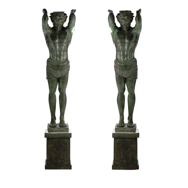 Inspired by the classical statues of ancient Greece and Rome, each of these two pieces in bronze with a green patina finish depicts an Atlas, which in classical European architecture was a pilaster sculpted in the form of a man. The Roman term for