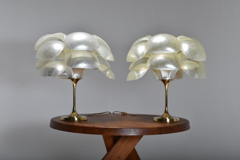 Rare set of two table lamps by Maison Rougier. The big opalescent petals diffuse beautiful and soft light. The lamps have a clear presence, and do not even need to be lighted, as one can see by the pictures. This model is quite rare, and a pair