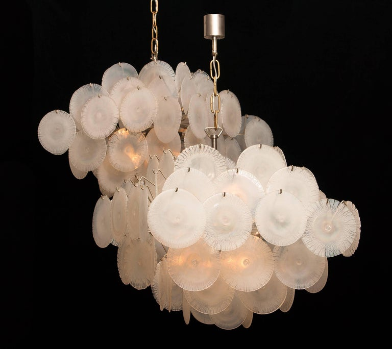 Extremely beautiful set of two Gino Vistosi chandeliers with white / pearl colored handmade Murano crystal discs.   These Gino Vistosi chandeliers are made in Italy in the 1960s. The chandeliers contains 60 Murano white / pearl colored crystal