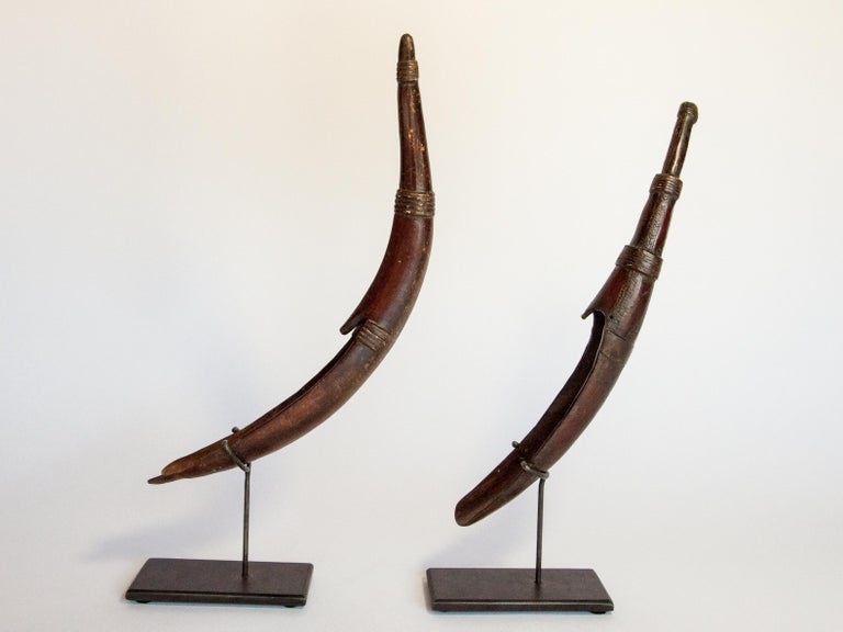 Set of two horn spoons from the Sidamo of Ethiopia. Mounted, mid-20th century. Used in Sidamo households as spice spoons. Graceful in form, and with a lovely patina. One piece, on the right in the photo, has some detailed geometric patterns etched