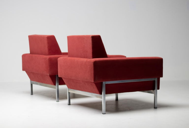 Saporiti club chairs in red fabric, Italy, 1960s. These chairs, equipped with a chromed steel frame, feature a very distinctive sloped back at the bottom. The frame forms a wonderful contrast to the red upholstered seat.