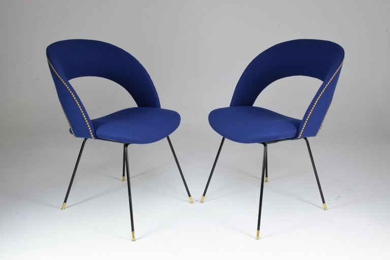 A pair of 20th century collectible side or accent chairs by Gastone Rinaldi for Rima who was one of Poltrona Frau's most emblematic designers of the midcentury period.  All our pieces are fully restored at our atelier and we only offer items that