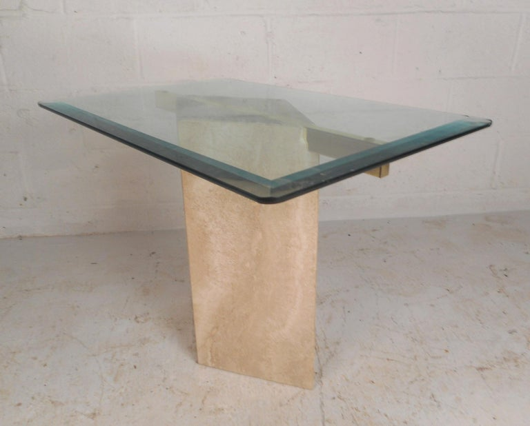 This stunning vintage modern end table and coffee table features a marble base with brass cross supports. An elegant Italian design with a cube base and a taller diamond shaped base. The large coffee table has two brass supports that allow the glass