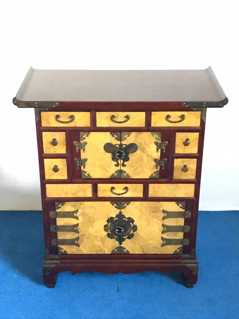 The cases are in a very good condition. There are many drawers and hidden drawers and brass fittings.