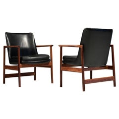 Set of Two Kofod-Larsen Armchairs in Black Leather and Teak, Denmark, 1960s