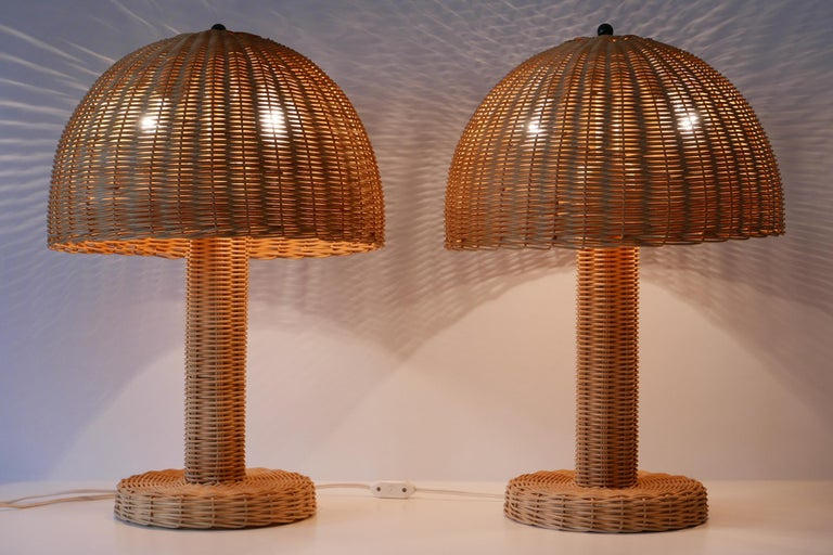Set of two large and elegant Mid-Century Modern wicker table lamps. Made probably in Italy, 1970s.  Each lamp comes with 2 x E27 Edison screw fit bulb holders. They are with original wiring, in working condition and run both on 110/230