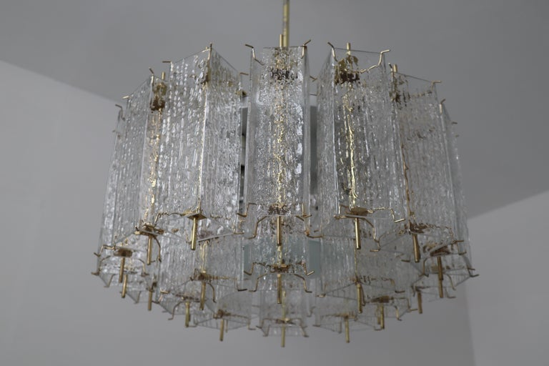 Mid-Century Modern Set of Two Large Midcentury Chandeliers with Ice Glass Tubes in Brass Fixture For Sale
