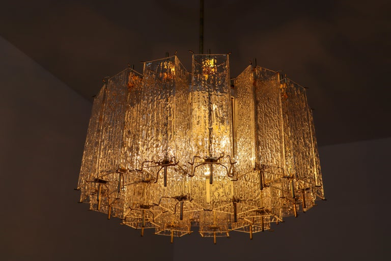 Set of Two Large Midcentury Chandeliers with Ice Glass Tubes in Brass Fixture In Good Condition For Sale In Almelo, NL