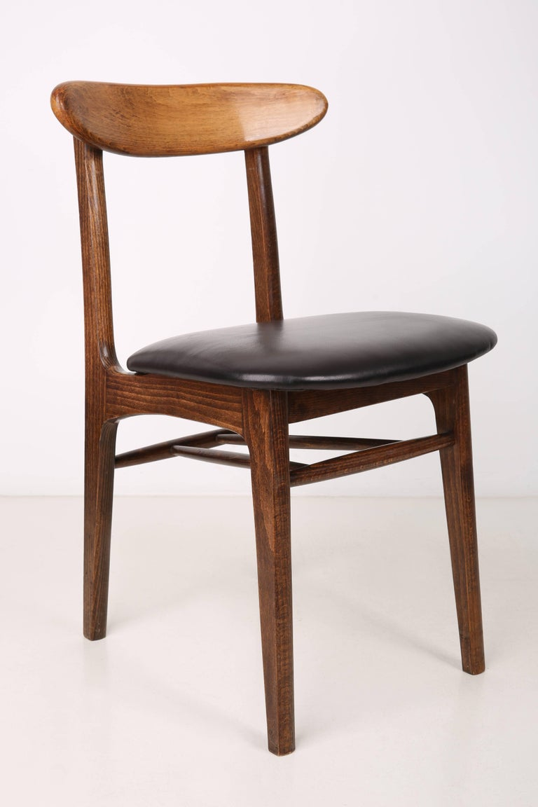 Chairs designed by prof. Rajmund Halas. They have been made of beech wood. They have undergone a complete upholstery renovation, the woodwork has been refreshed. Seats and backs were dressed in black natural cow leather. They are stable and very