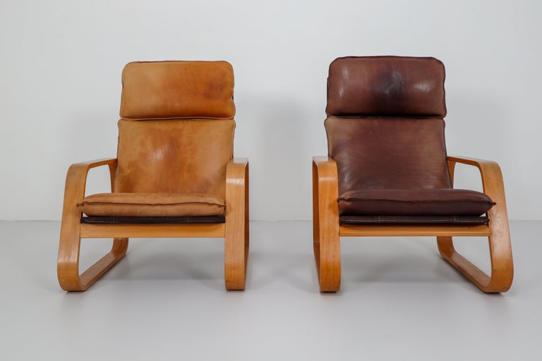 French Set of Two Lounge Chairs, Patinated Leather and Bentwood, France, 1970s For Sale