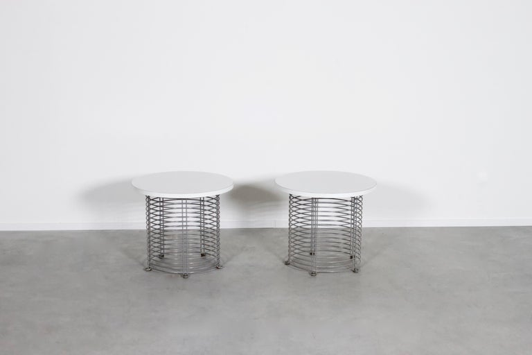 Set of 2 Pantonova end/coffee tables in very good condition.  Designed by Verner Panton in 1971.   Produced by Fritz Hansen, Denmark  The tables consist of parallel chromed wire rods and a white Formica top.  The Pantonova series were designed and
