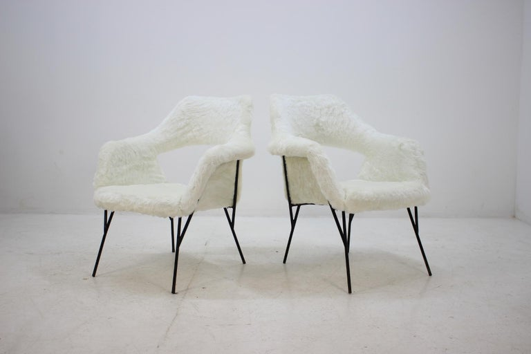 Very rare to seen. Fiberglass shells. Newly upholstered in synthetic sheep skin fabric.