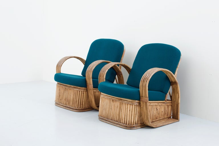 Two typical Bohemian rattan chairs in good condition. The cushions have been reupholstered recently with green wool so they are quite fresh. The design is striking because of the contrast between the rounded arm legs and the straight rattan slats