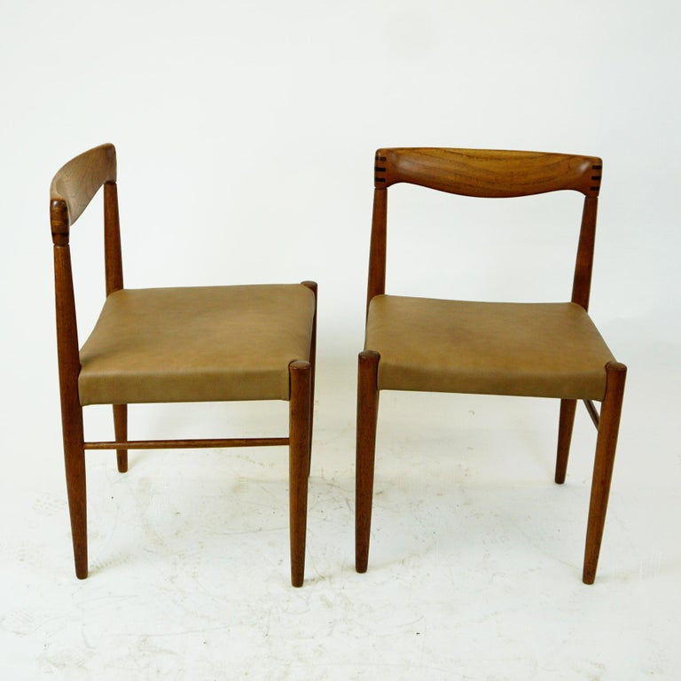 Rare and original Scandinavian midcentury dining chairs designed by Henry Walter Klein for Bramin Mobler Denmark in the 1960s. The frame is made from solid teak with renewed Leather seats and beautiful handcrafted details! These chairs will be