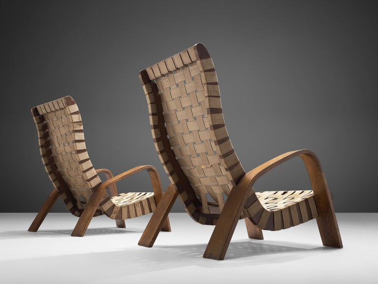 Pair of armchairs with ottoman, plywood, beige canvas, Czech Republic, 1950s.  These wavy, elegant armchairs with a high back is executed in a bent beech frame. The soft beige upholstery is woven and emphasizes the original character of the lounge