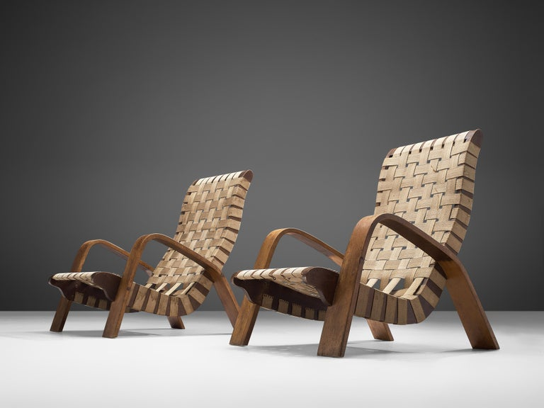Mid-20th Century Set of Two Sculptural Lounge Chairs with Ottomans For Sale