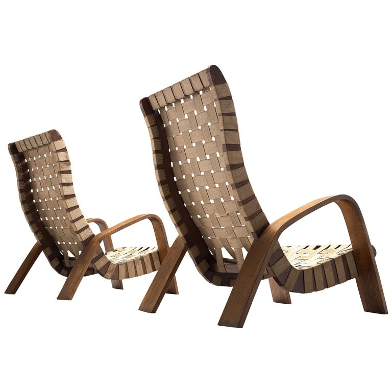Set of Two Sculptural Lounge Chairs with Ottomans For Sale
