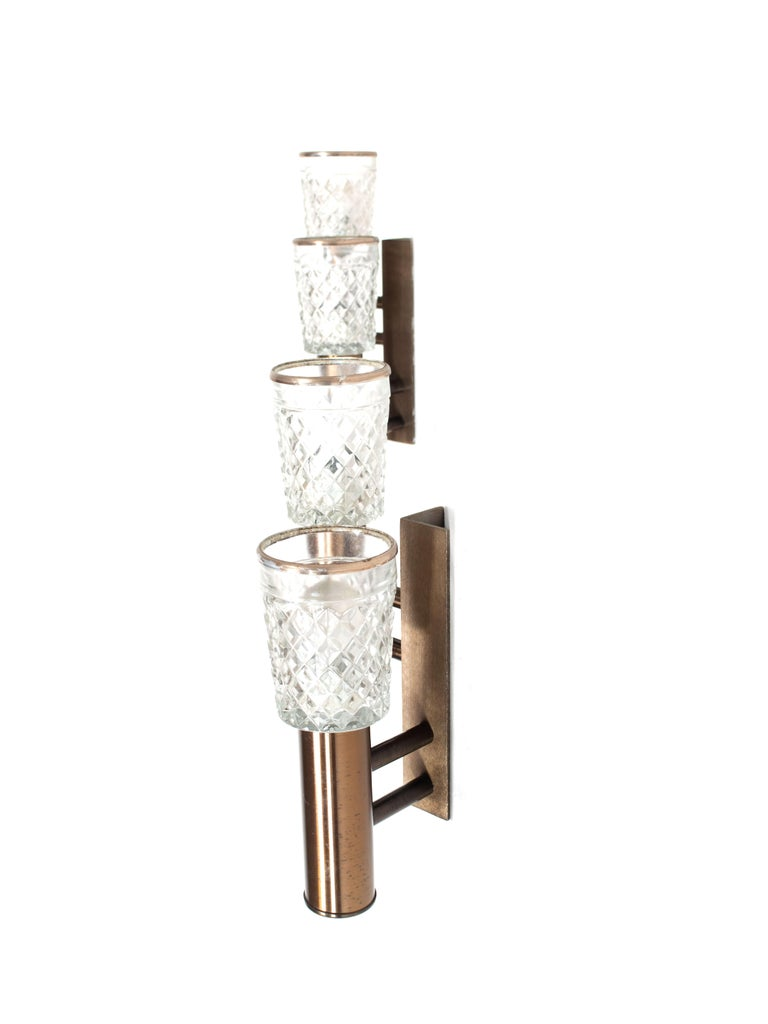 Set of two stilux wall appliques in glass and metal from Italy, 1960s. These lights have an amazing design with a bronze colored base and crystal style glass. They both have two lights on a base of metal. The lights are in good condition with normal