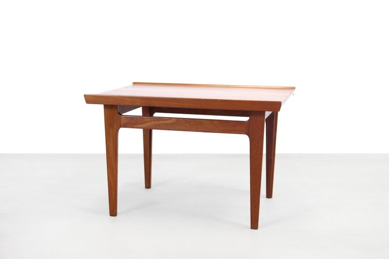 Two special side tables made of solid teak. Designed by the great and well-known Danish designer Finn Juhl and produced by France and Son, Denmark in the 60s. The tables have a raised edge on two sides and the design of the legs has also been