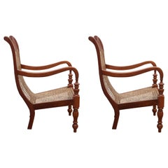 Set of Two Teak Wood and Cane Lounge Chairs from Colombo Area of Sri Lanka
