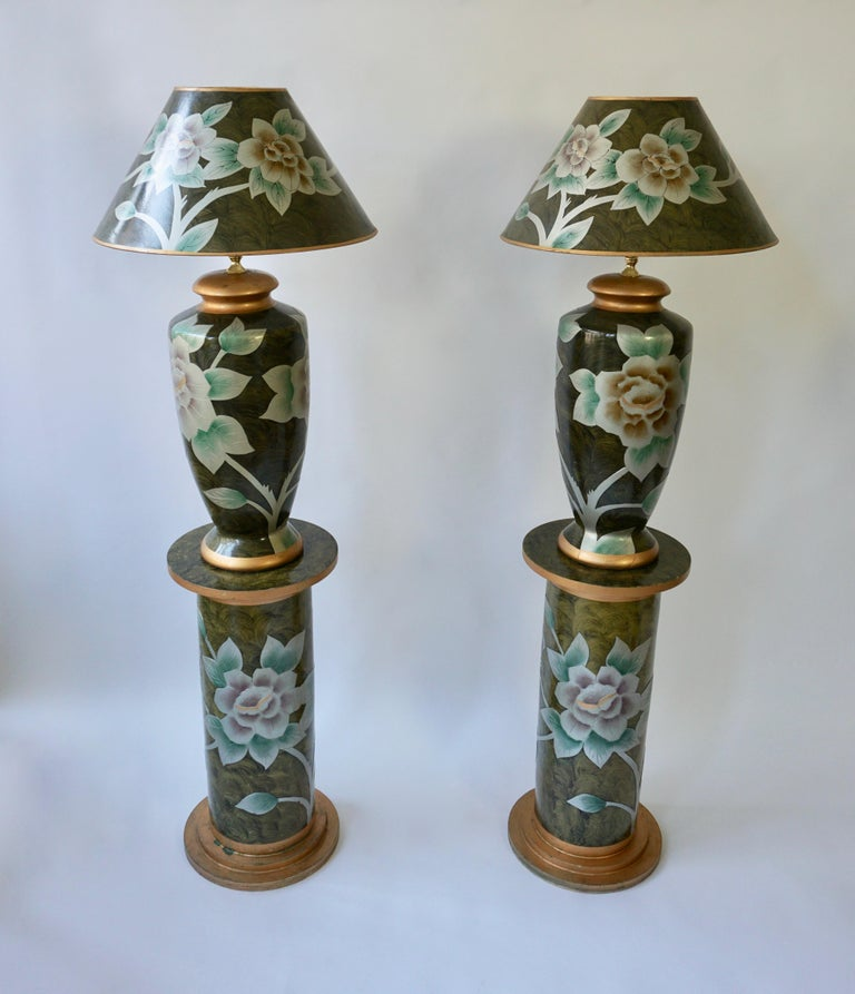 Two beautiful terracotta table lamps on two pedestals. Italy, 1970s. The price is for the two table lamps with the two columns.  Measures: Height table lamp 88 cm, diameter 50 cm. Height pedestal 69 cm, diameter 33 cm. Total height 157 cm. One