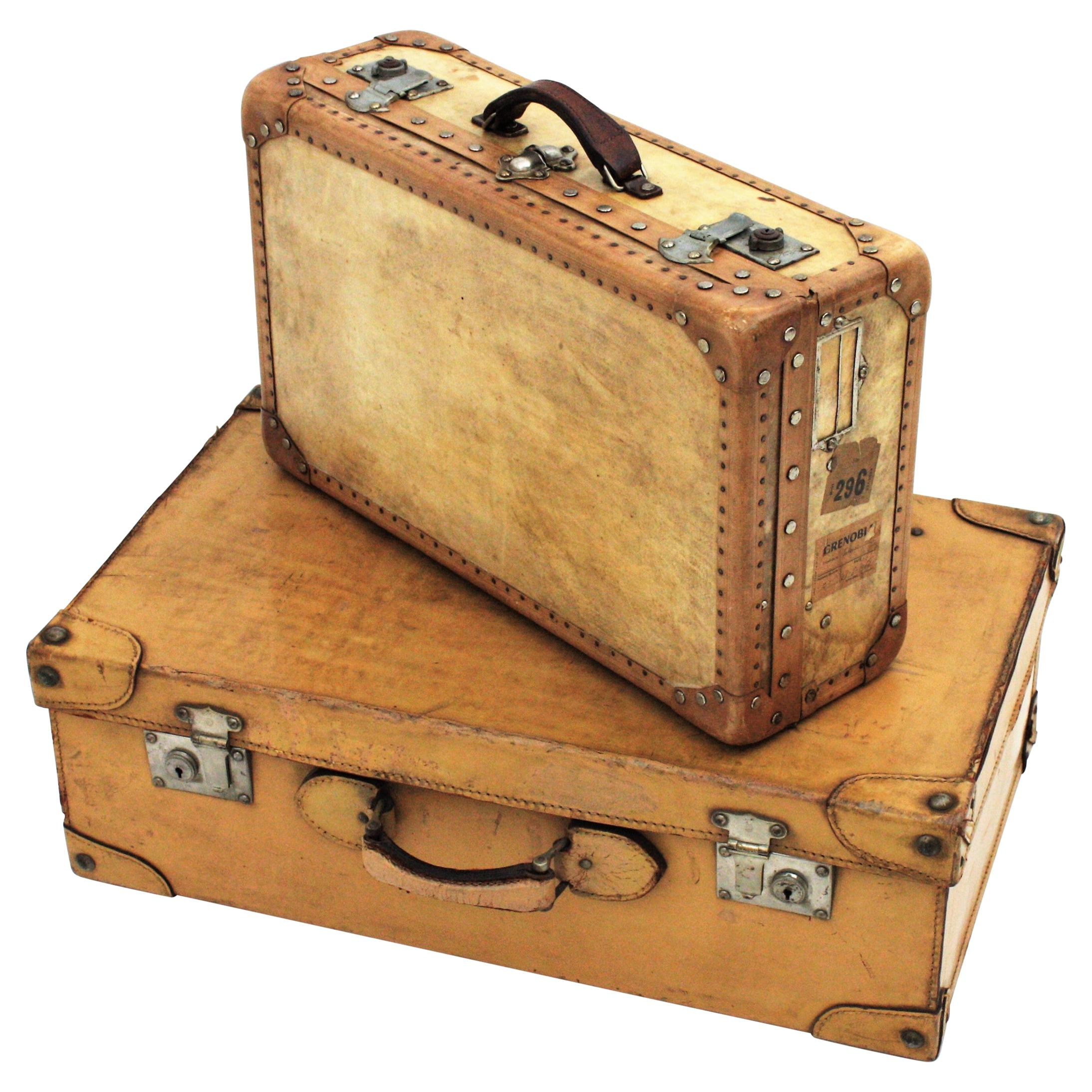 Set of Two Vellum and Leather French 20th Century Suitcases