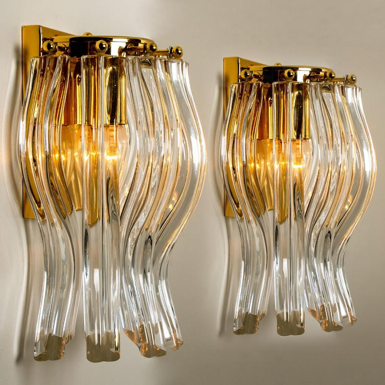 Beautiful pair of Murano glass wall sconces featuring four crystal clear glass